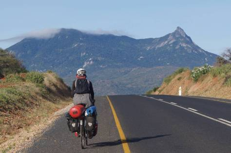 julie-cycles-past-mountain-scenery-in-tanzania