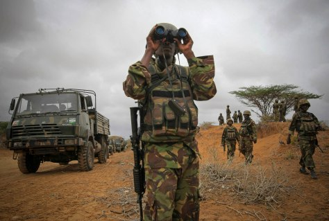 An officer from the Kenyan Contingent of the African Union Mission in Somalia (AMISOM) looks through binoculars during an advance on the Somali port city of Kismayu, in this handout photograph taken October 2, 2012 by the African Union-United Nations Information Support Team and released October 3, 2012. African Union troops and tanks occupied al Shabaab's former stronghold of Kismayu on Tuesday, but the Somali Islamist militants gave notice of their intention to fight back, saying they detonated a bomb in the port city. MANDATORY CREDIT. REUTERS/African Union-United Nations Information Support Team/Stuart Price/Handout (SOMALIA - Tags: MILITARY POLITICS CIVIL UNREST CONFLICT) FOR EDITORIAL USE ONLY. NOT FOR SALE FOR MARKETING OR ADVERTISING CAMPAIGNS. THIS IMAGE HAS BEEN SUPPLIED BY A THIRD PARTY. IT IS DISTRIBUTED, EXACTLY AS RECEIVED BY REUTERS, AS A SERVICE TO CLIENTS
