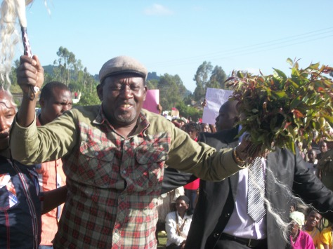 tigania-east-mp-mpuru-aburi-whisks-a-bunch-of-miraa-in-mailitatu-stadium