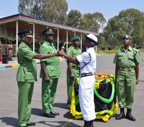 Jephitha-Maingi-receives-a-medal-of-exemplary-performance-from-NYS-Deputy-Director-General-Mr.-Muchiri..jpg